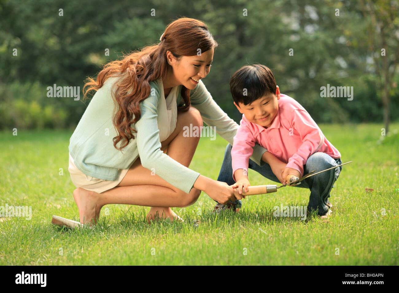 Mother And Son Pron Grass With Tools Stock Photo 27667997 - Alamy-8932