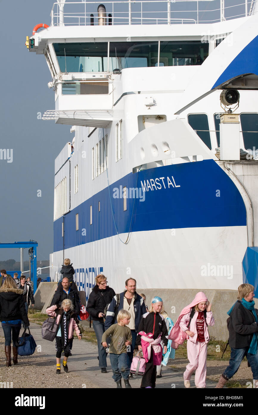 Arriving passengers at the ferry harbor at Rudkøbing. - Stock Image