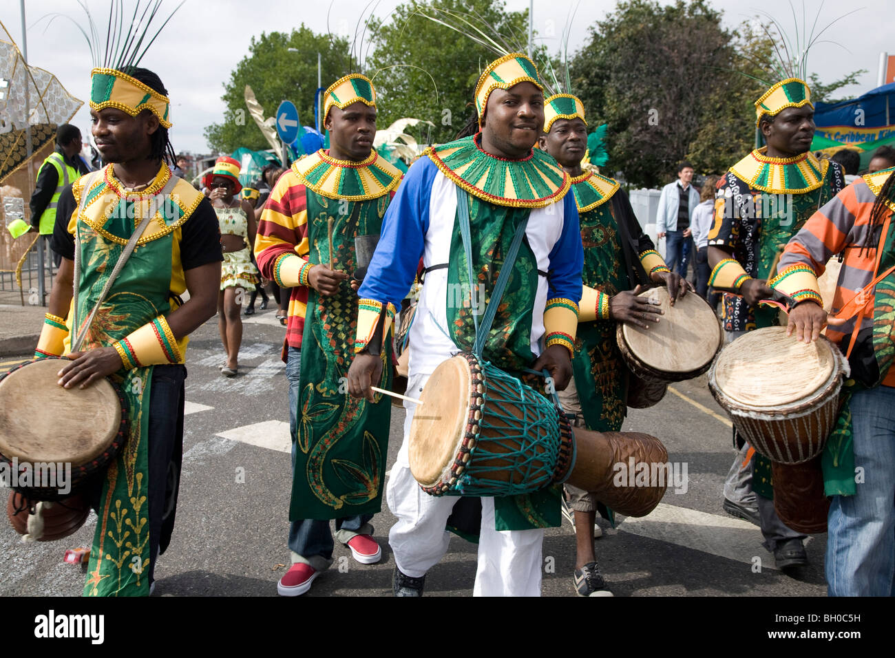 Young men in carnival costume. Band of drummers. Notting Hill Carnival, Notting Hill. London. England. UK. - Stock Image