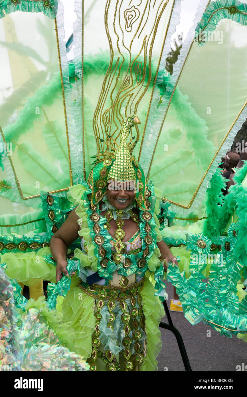 Mature woman in carnival costume. Notting Hill Carnival, Notting Hill. London. England. UK. - Stock Image