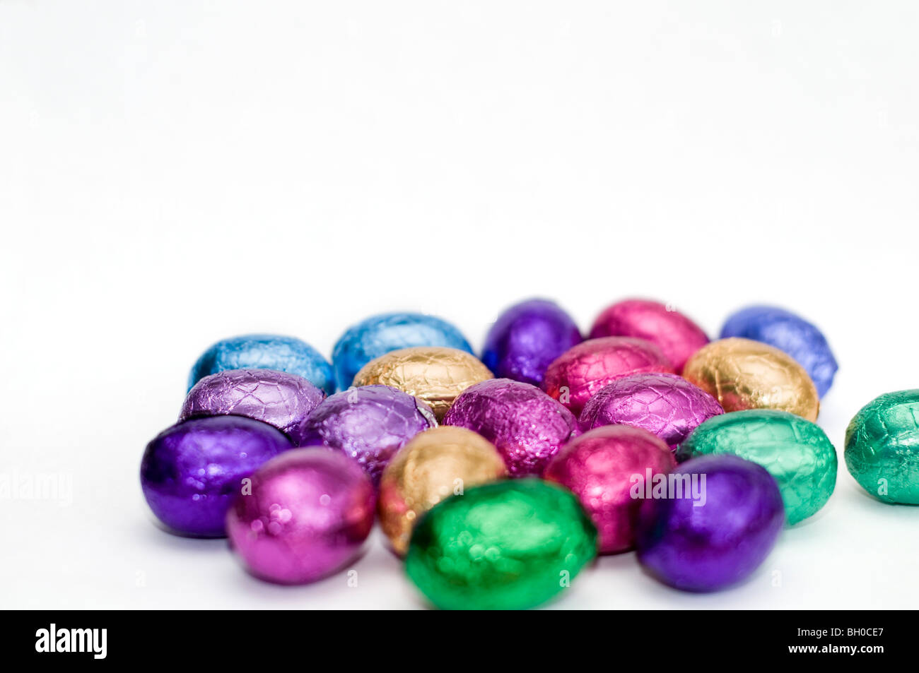 A selection of colorful mini chocolate Easter eggs on a white background Stock Photo
