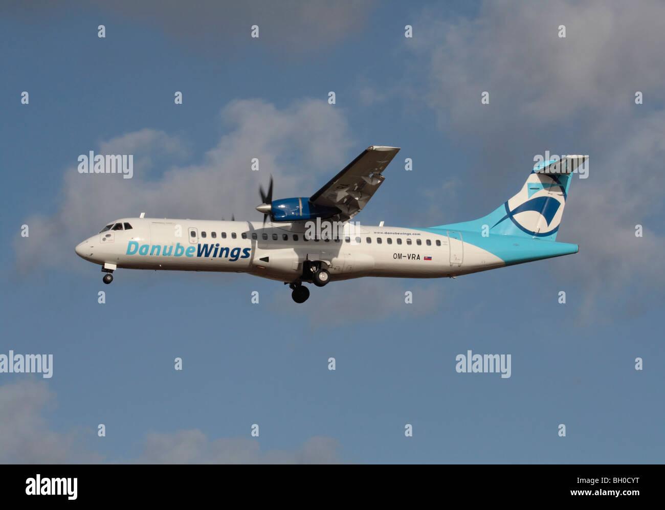 Danube Wings ATR 72 turboprop regional airliner in flight. Short haul civil aviation. - Stock Image