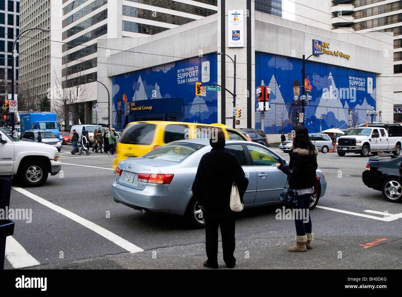 Corner of Burrard and Georgia St in Vancouver, looking at Royal Bank Tower, getting wrapped in giant banner for - Stock Image