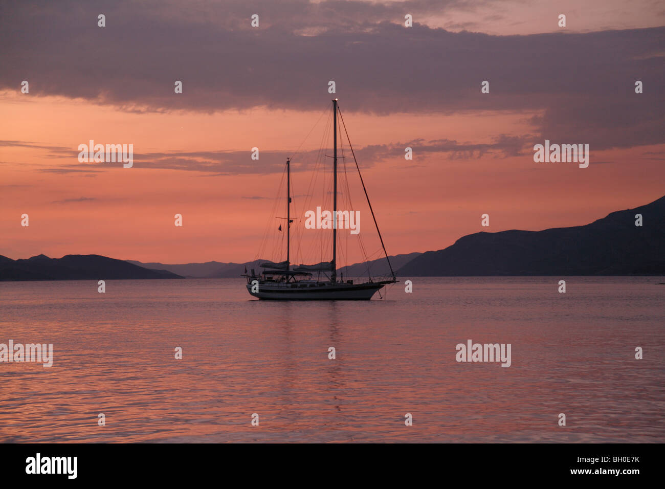 Moored yacht at  sunset Donje Celo harbour, Kolocep, South Dalmatia Croatia one of the Elaphite islands near Dubrovnik Stock Photo