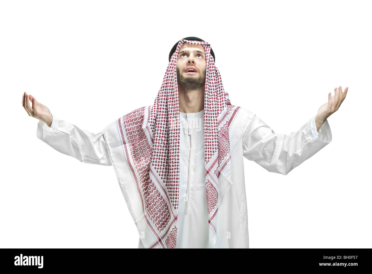 Arabic man praying, isolated on white background - Stock Image