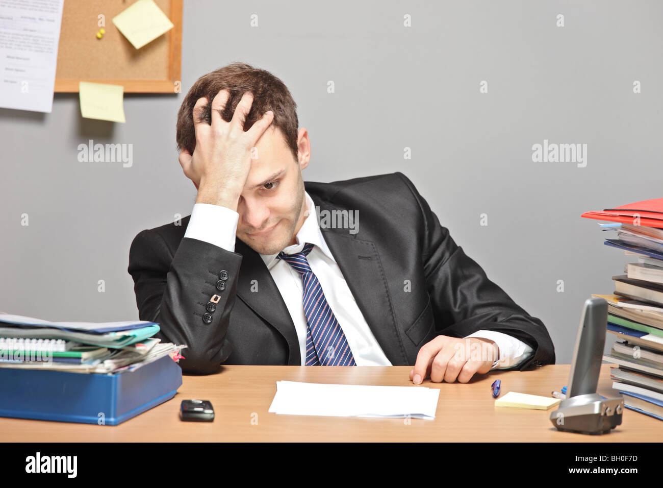 Sad businessman in the office - Stock Image