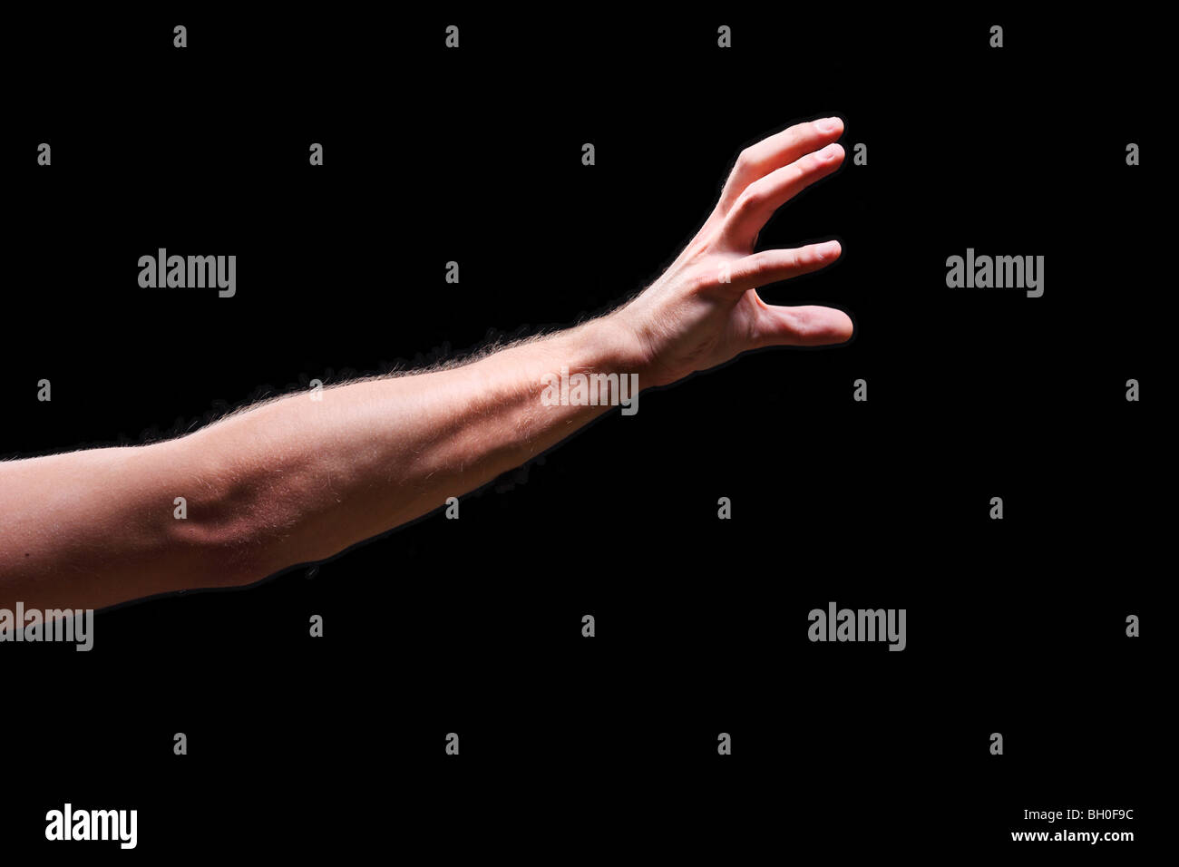 Hand isolated on black - Stock Image