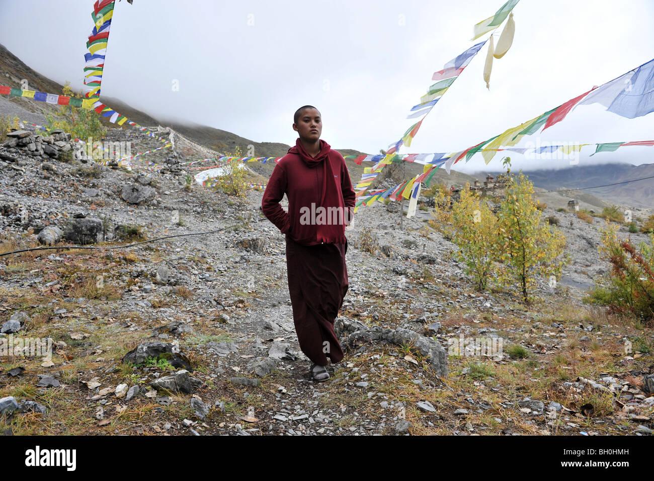 Asia, Nepal, a Buddhist priest and prayerflags - Stock Image
