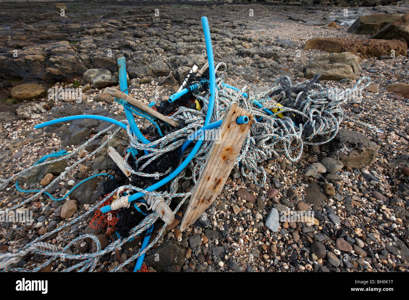 Flotsam on a British beach - Stock Image