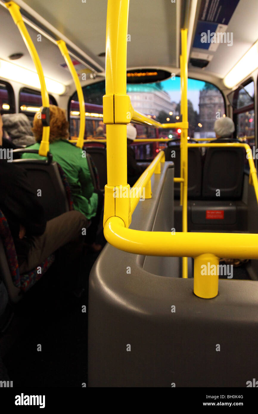 London doubledecker bus interior view of upstairs at dusk - Stock Image