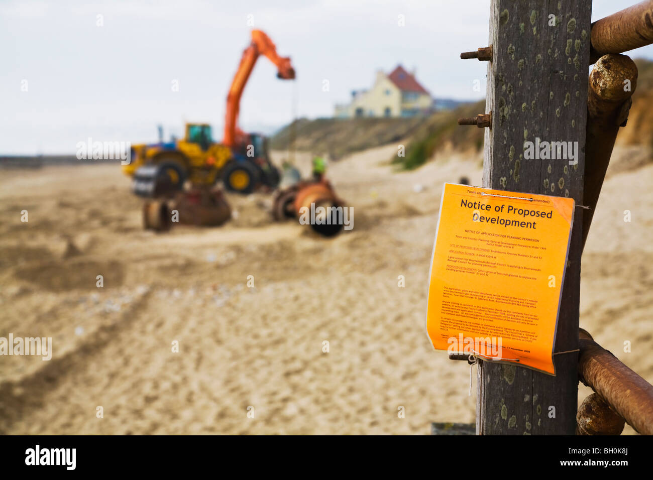 A Planning Notice of proposed maintenance on Bournemouth beach.  Construction of replacement groynes and pipe laying. Stock Photo