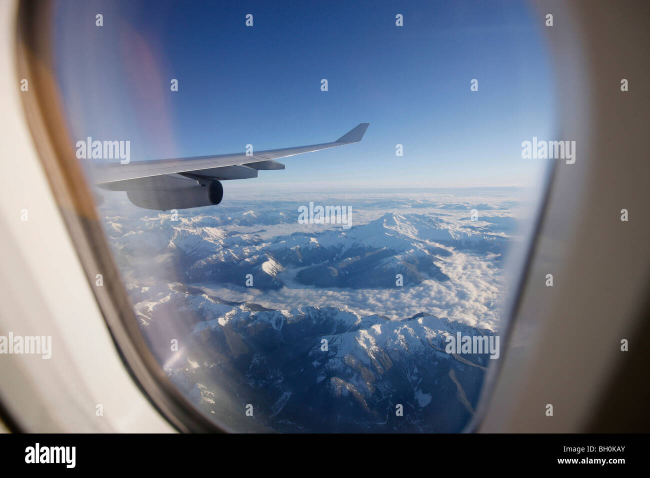 View through airplane window over Rocky Mountains, Oregon, USA - Stock Image