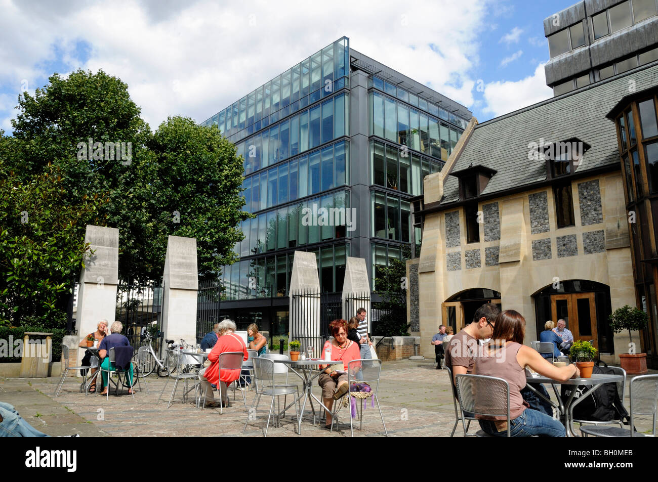 People Sitting At Cafe Tables Outside Southwark Cathedral London England UK