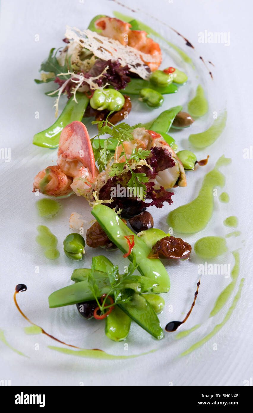 Lobster salad with sugar snaps in restaurant Tilia, Chef Chris Oberhammer, Vintl South Tyrol, Italy - Stock Image