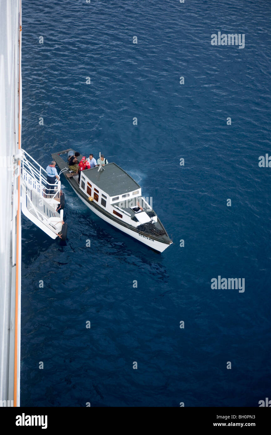 Pilot cutter alongside Cruiseship MV Columbus, Tonga, South Pacific, Oceania - Stock Image