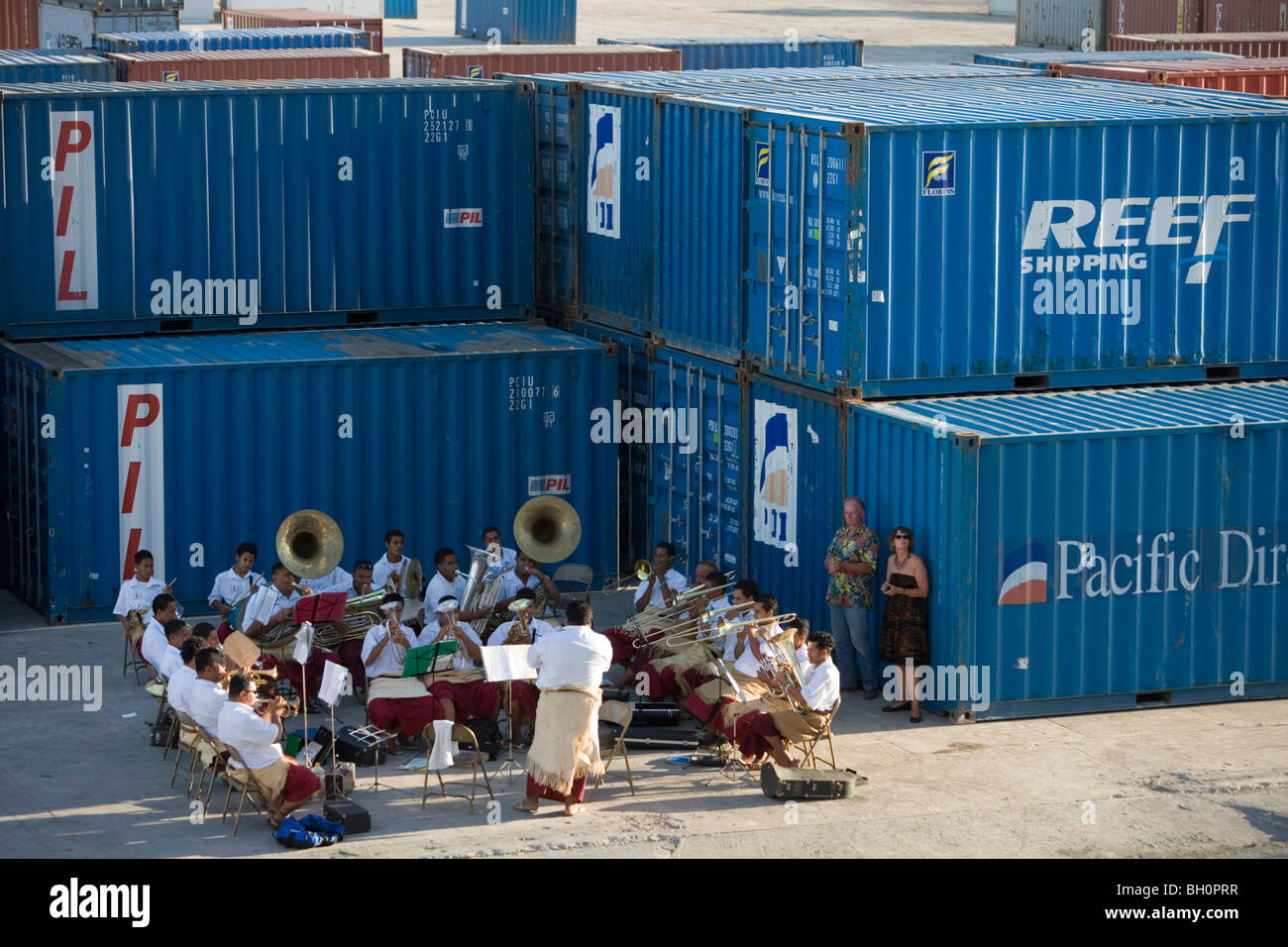 Tongan Brass Band playing amidst containers at harbour, Nuku'alofa, Tongatapu, Tonga, South Pacific, Oceania Stock Photo