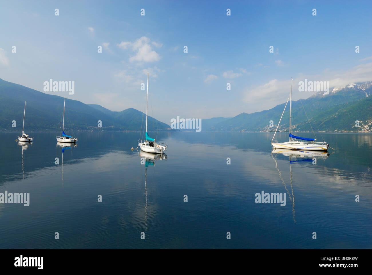 Sailing boats anchored at lake Maggiore, Ascona, lake Maggiore, Lago Maggiore, Ticino, Switzerland - Stock Image