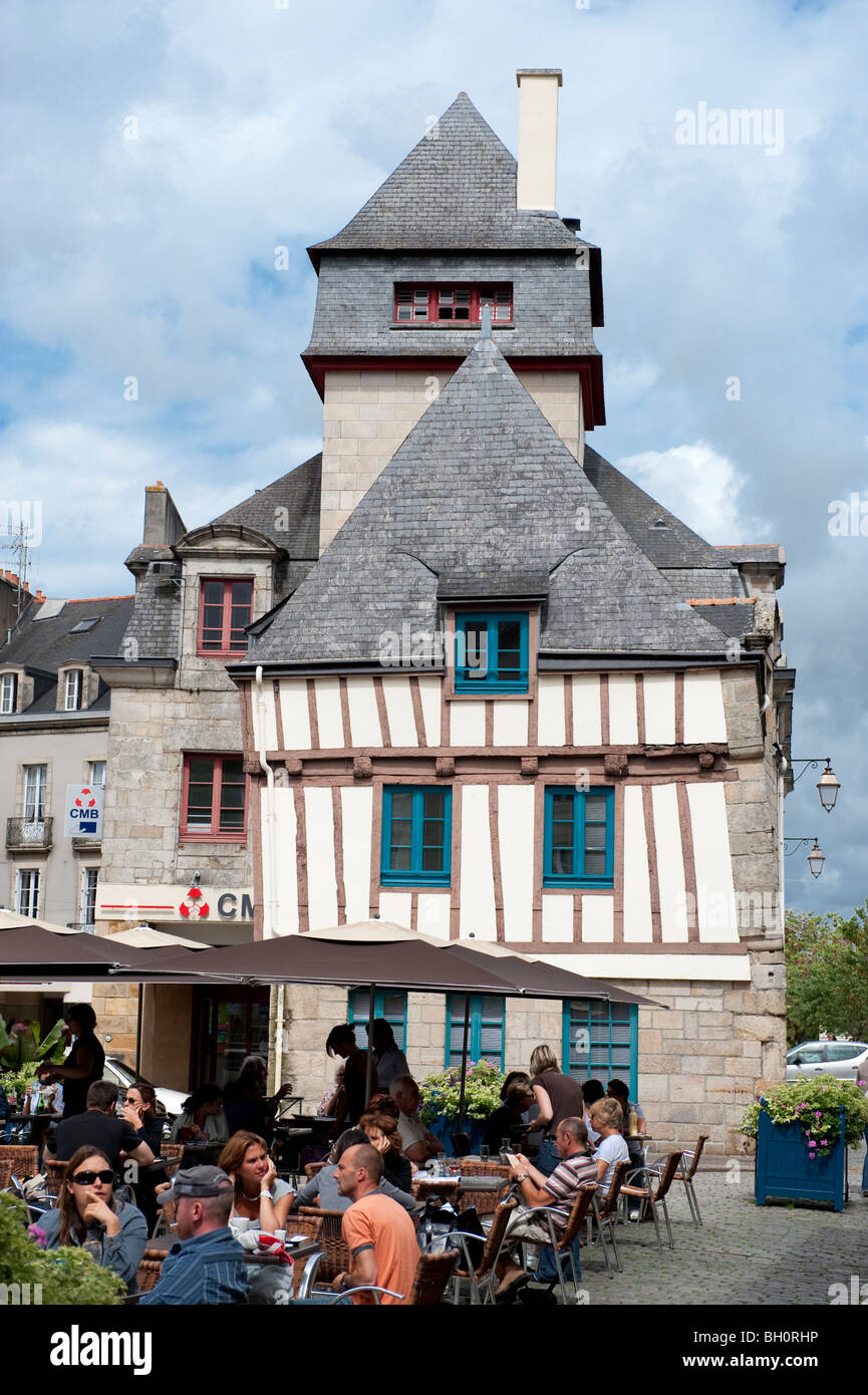Street cafe in Quimper, Brittany with half timbered medieval buildings in the background Stock Photo