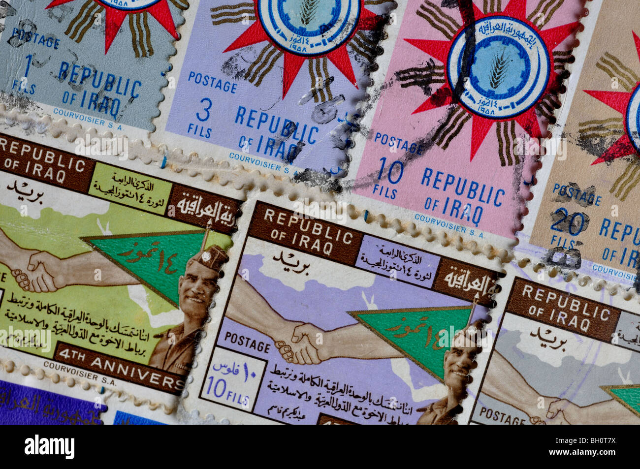 Iraq postage stamps in stamp album - Stock Image