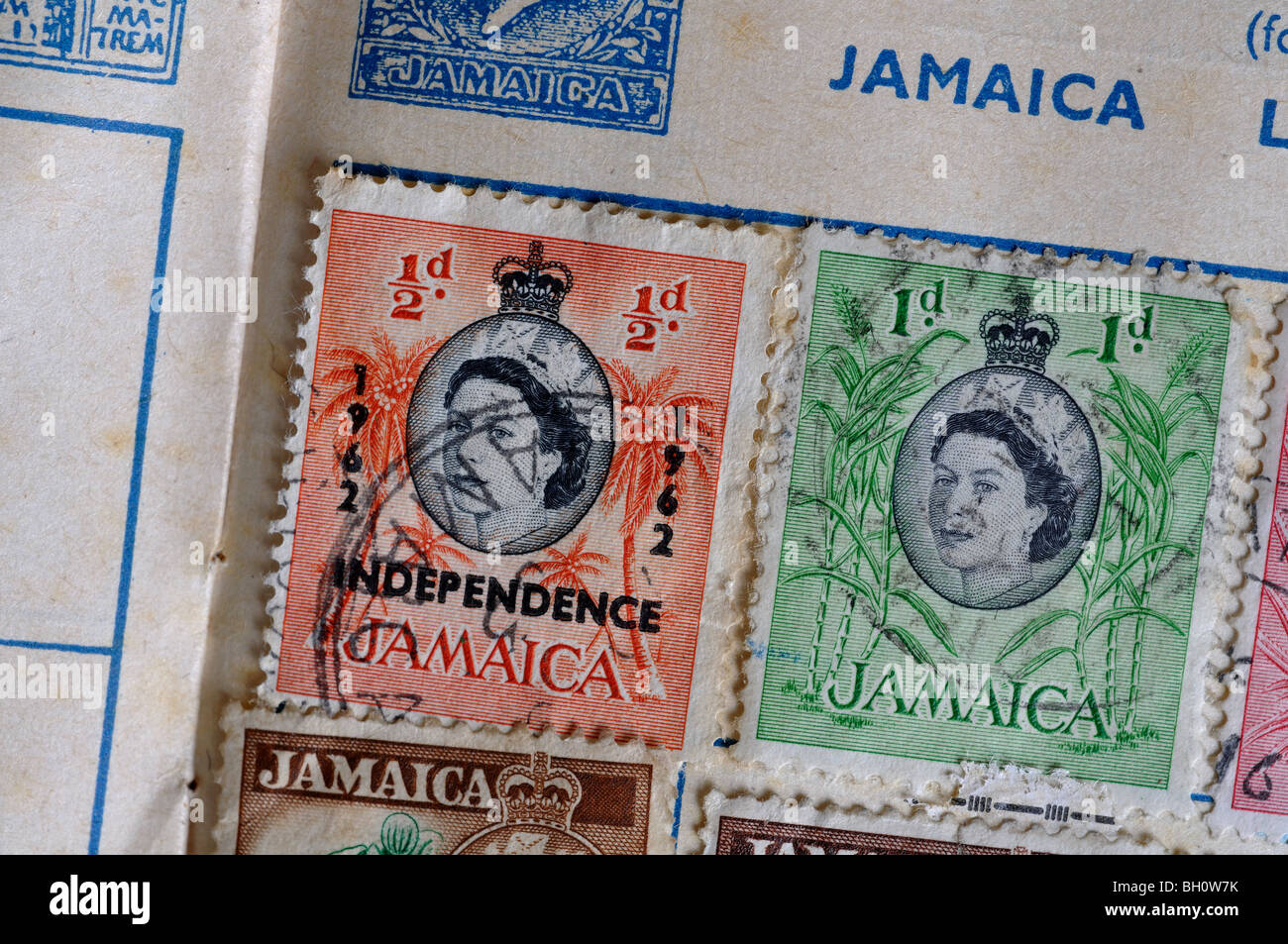 Jamaica postage stamps in stamp album - Stock Image