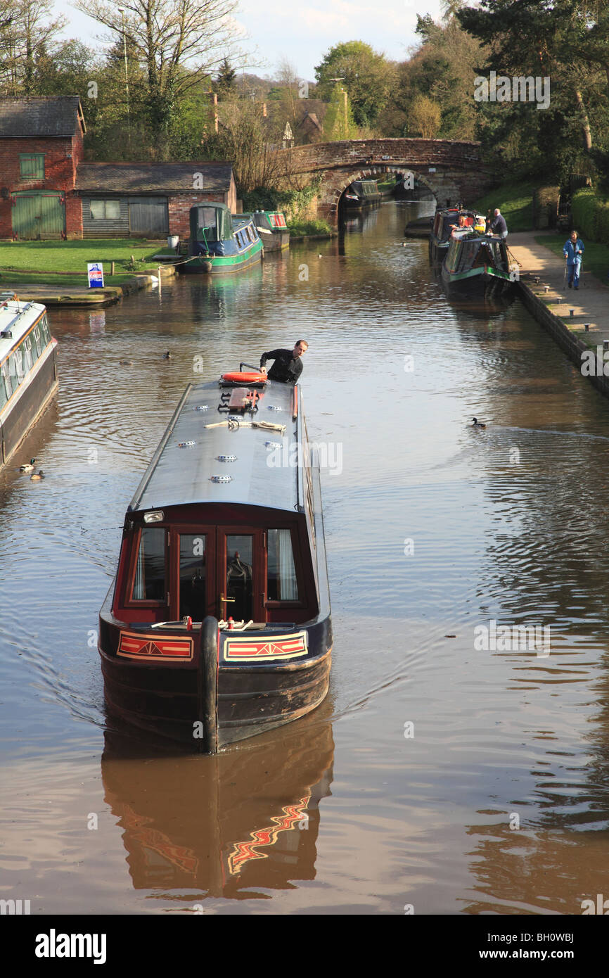 """A narrowboat, hired from the holiday company """"Black Prince"""", cruising on the Shropshire Union Canal at Market Drayton - Stock Image"""