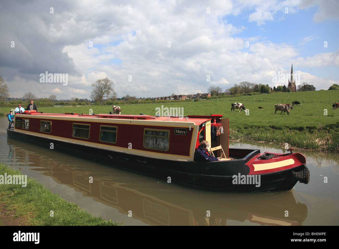 Holiday cruising on the Oxford Canal at Braunston, Northamptonshire in a hire boat from the Ashby Boat Company - Stock Image