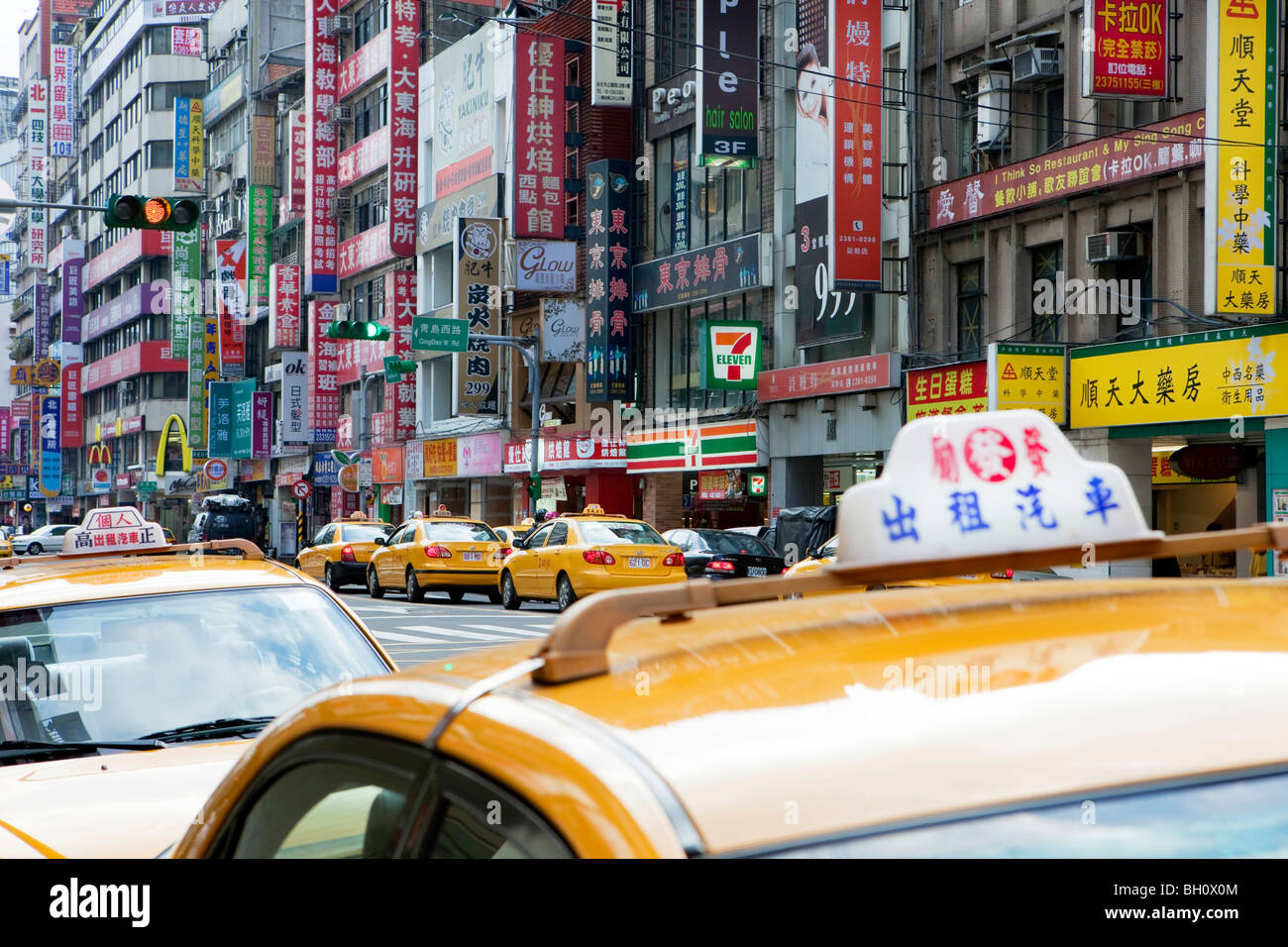 Street setting, taxis and neon lights at main station district, Taipei, Taiwan, Asia - Stock Image