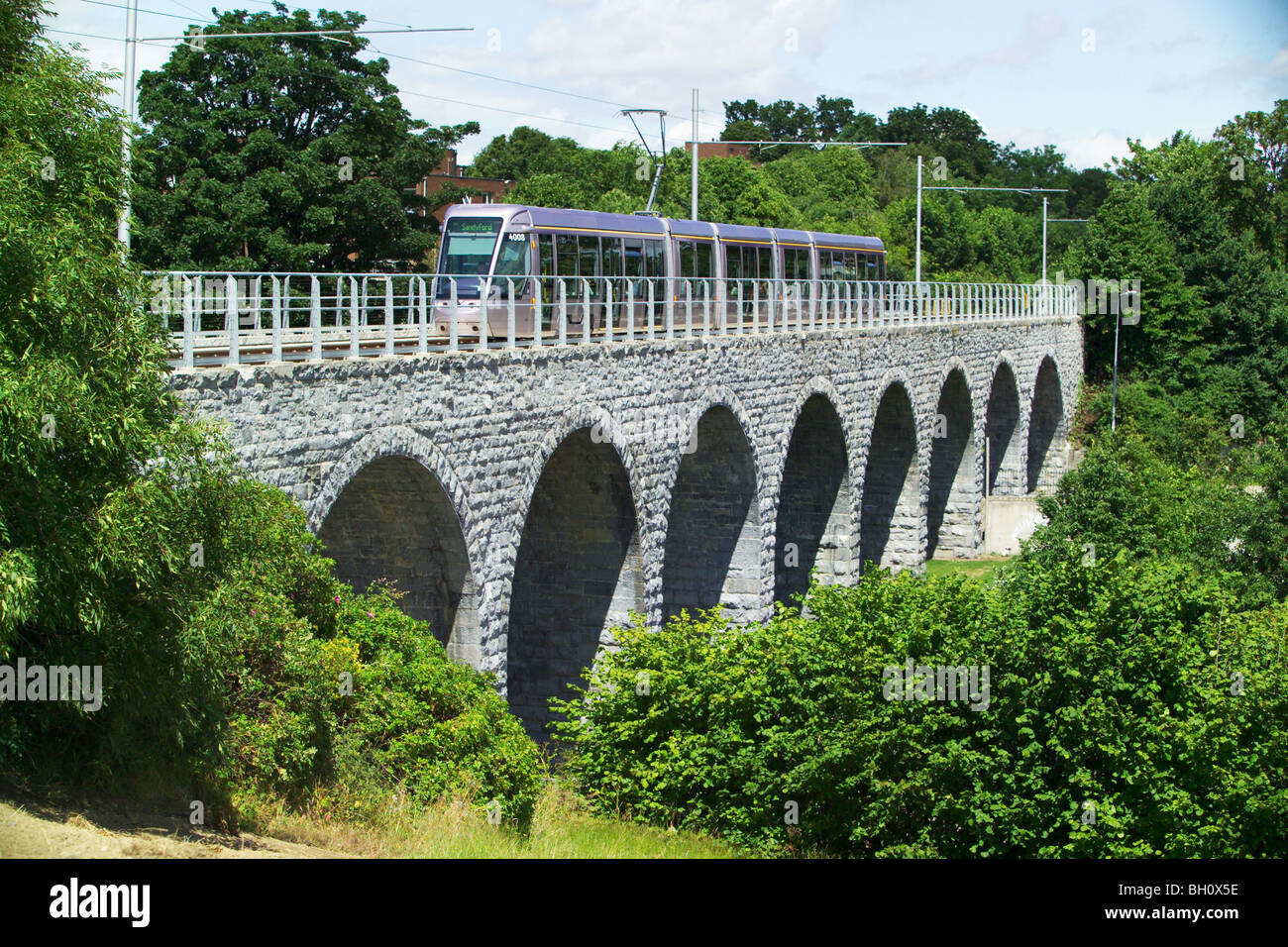 LUAS tram crossing Milltown Bridge, Dublin, Ireland Stock Photo