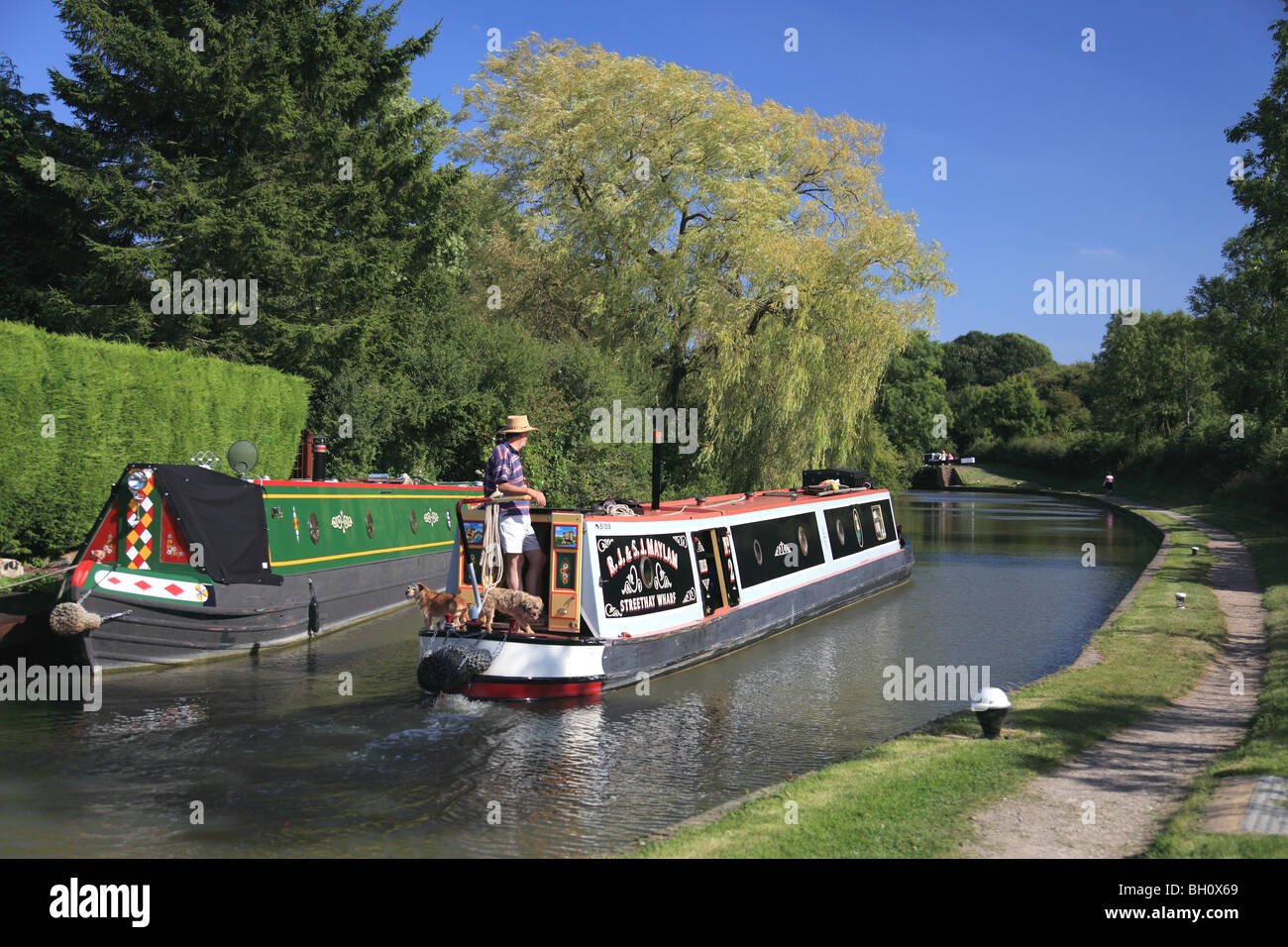 Holiday cruising on the Grand Union Canal between locks 3 and 4 at Braunston, Northamptonshire - Stock Image