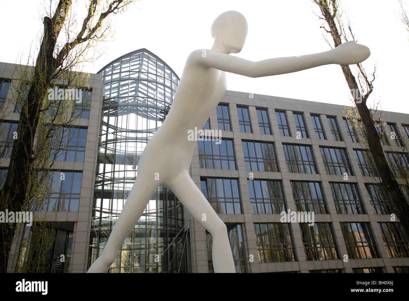walking man giant sculpture before th building of th allianz stock photo 27680090 alamy. Black Bedroom Furniture Sets. Home Design Ideas