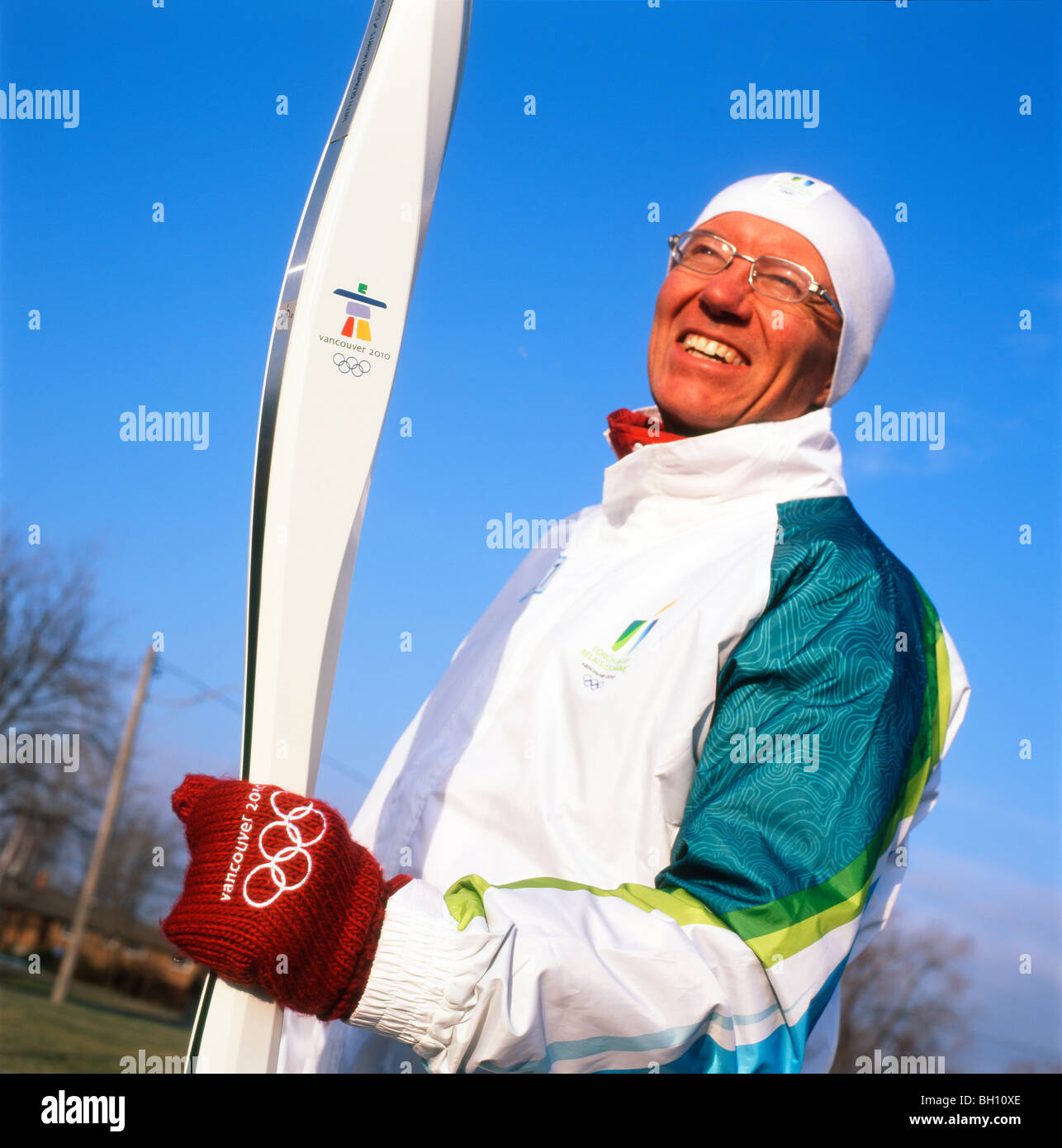A torch bearer for the 2010 Vancouver Winter Olympic Games Fort Erie Ontario Canada  KATHY DEWITT Stock Photo