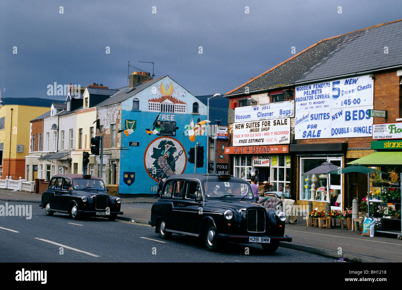 Vintage cars in front of facades of houses at Falls Road, Belfast ...