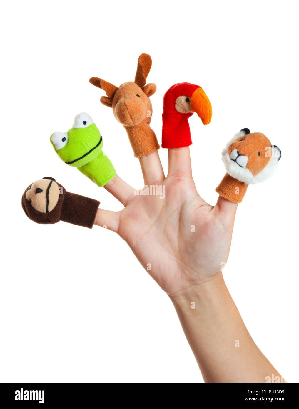 Female hand wearing 5 finger puppets; monkey, frog, reindeer, parrot; lion - Stock Image