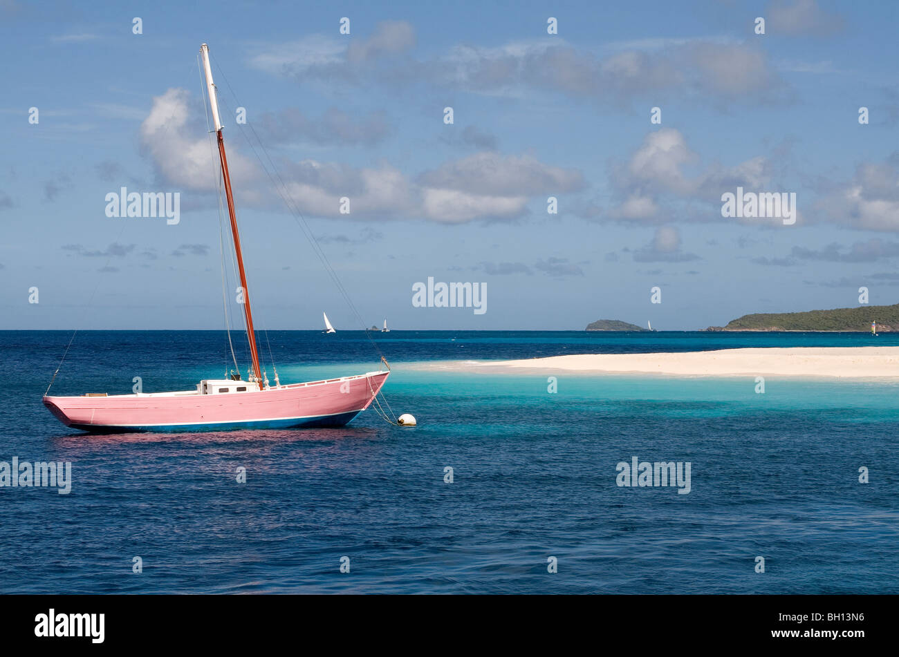 Desert Island, Pink Boat and Turquoise Sea. - Stock Image