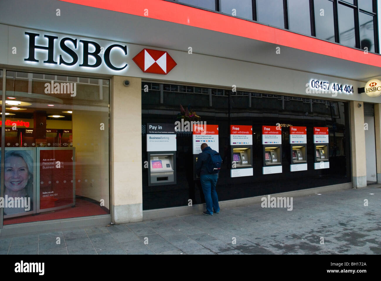 Person using HSBC cash dispenser Liverpool One shopping area Liverpool Merseyside England UK Europe - Stock Image