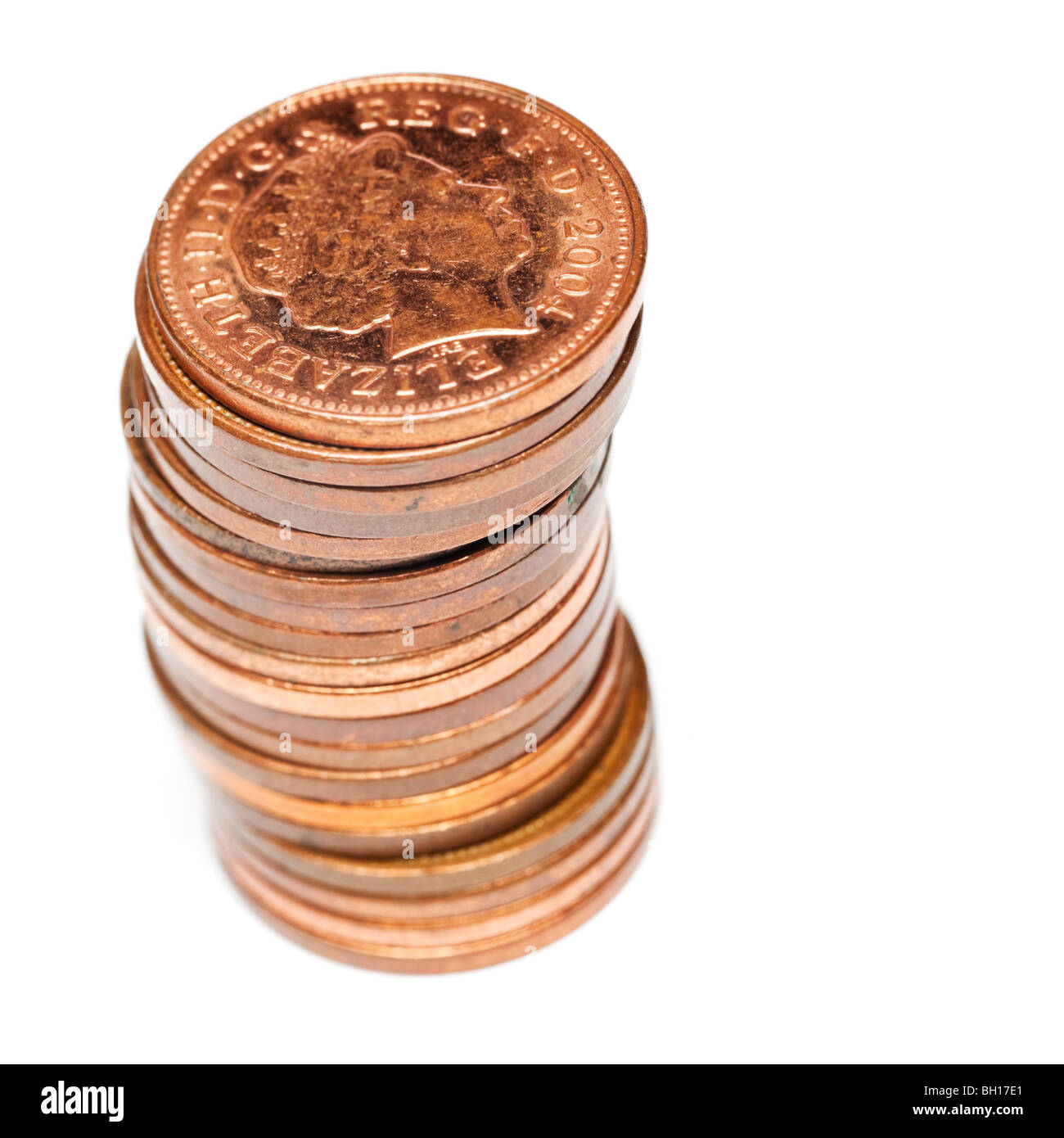 Stack of British one pence coins pieces - macro close up selective focus - Stock Image