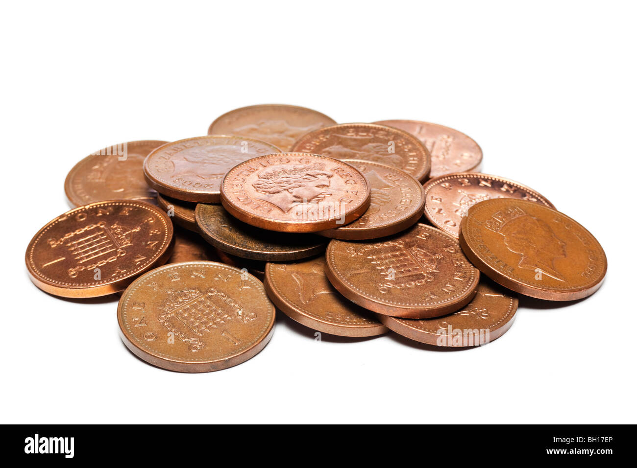 Pile of British uk GBP one pence coins close up - Stock Image