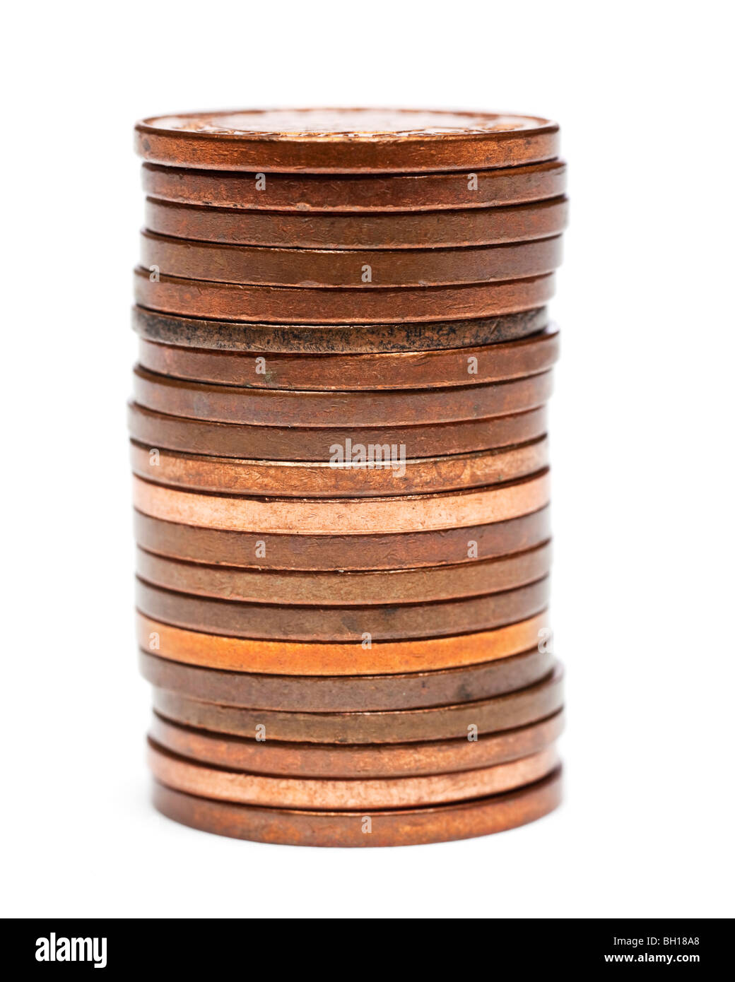 Stack of British one pence pieces close up selective focus - Stock Image