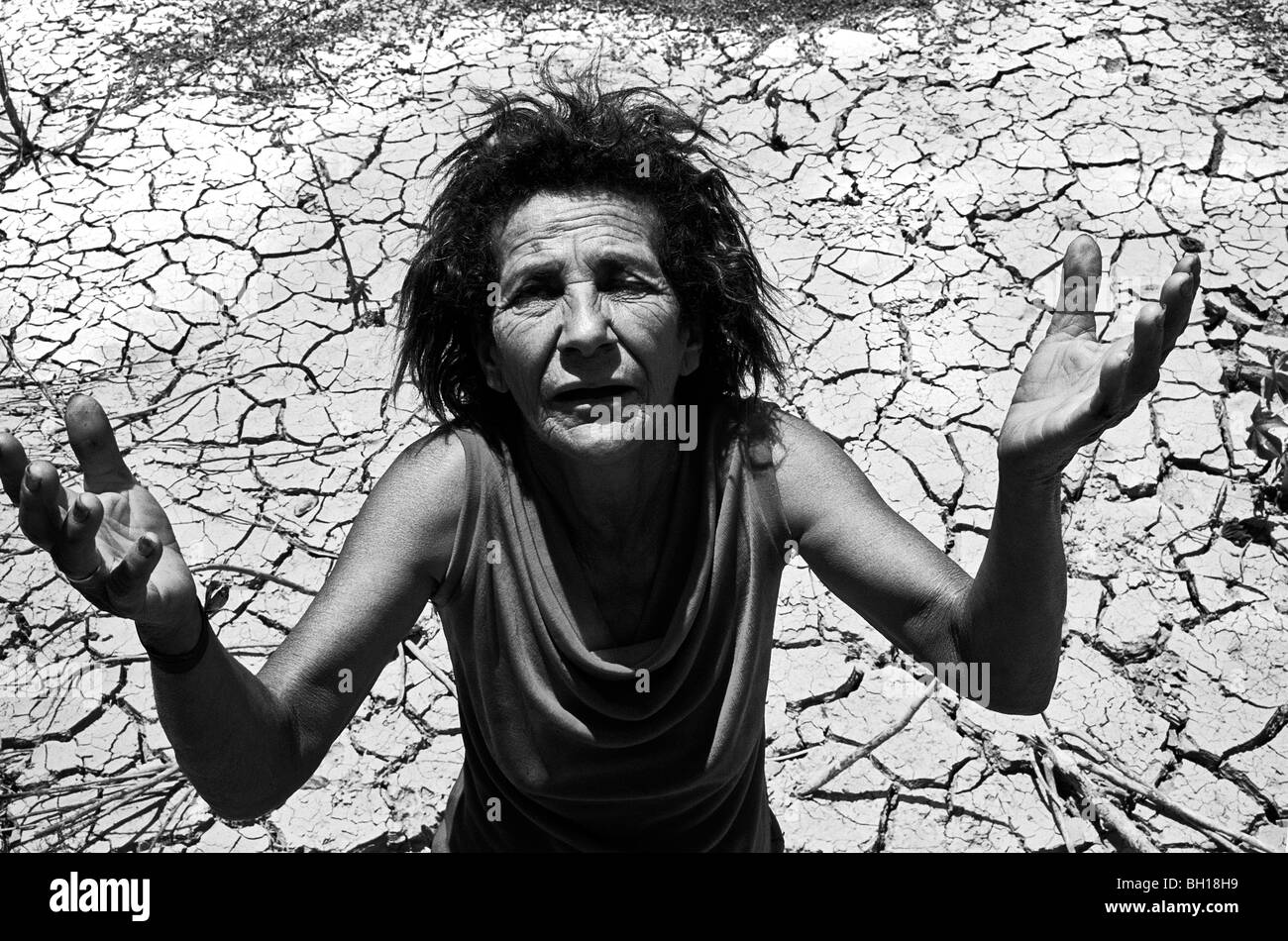 Woman resists on her land already devastated by eucalyptus planting, North Minas Gerais State, Brazil. - Stock Image