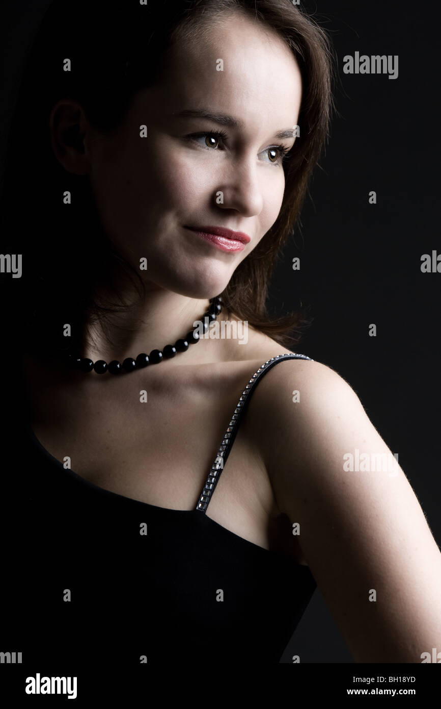 Beautiful Shot of a Gentle Brown Haired Lady - Stock Image