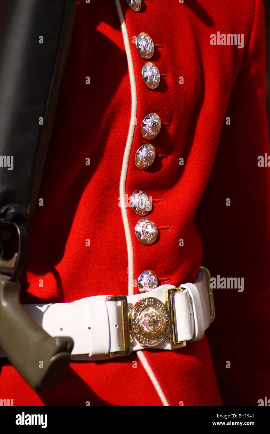 British Soldier's Regimental Red Tunic Detail on Guard at The Tower of London, City of London, United Kingdom. - Stock Image