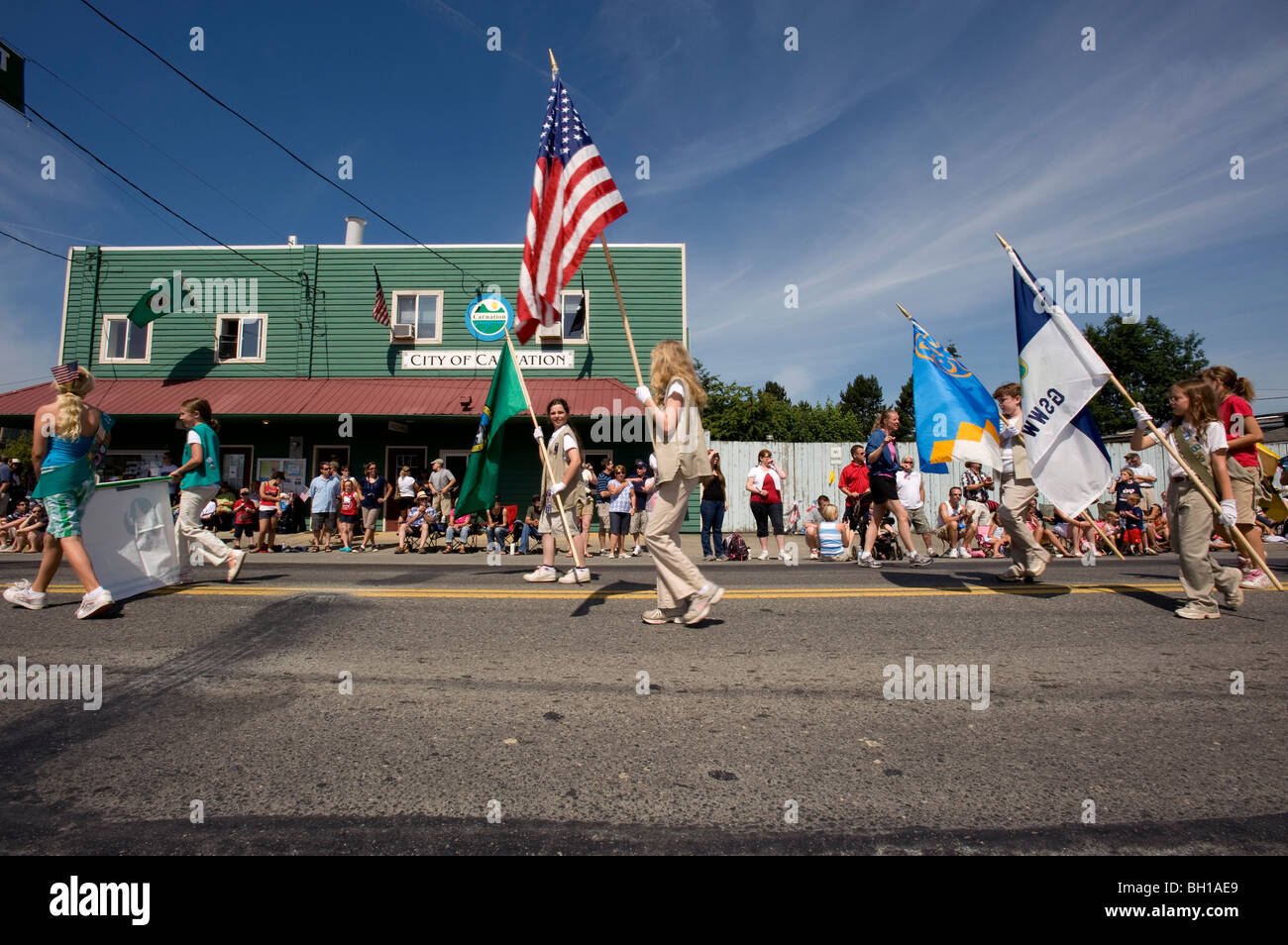 Girl Scouts participating in the Fourth of July parade. - Stock Image