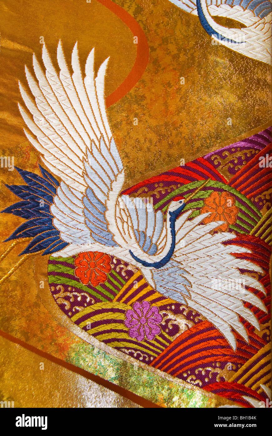 Asian brocade fabric with crane pattern, close-up - Stock Image