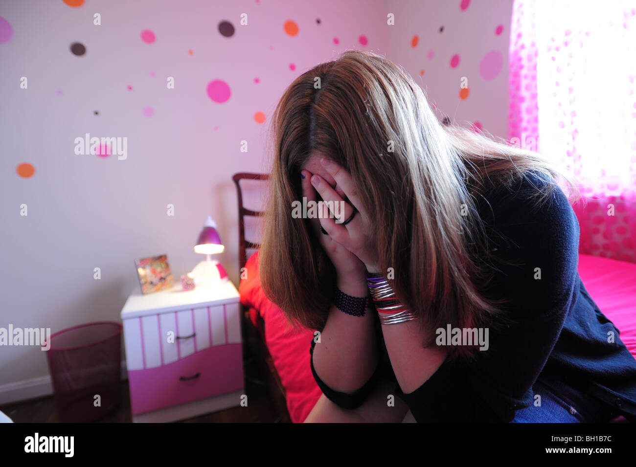 14 year old girl teenager with depression upset in her bedroom MR