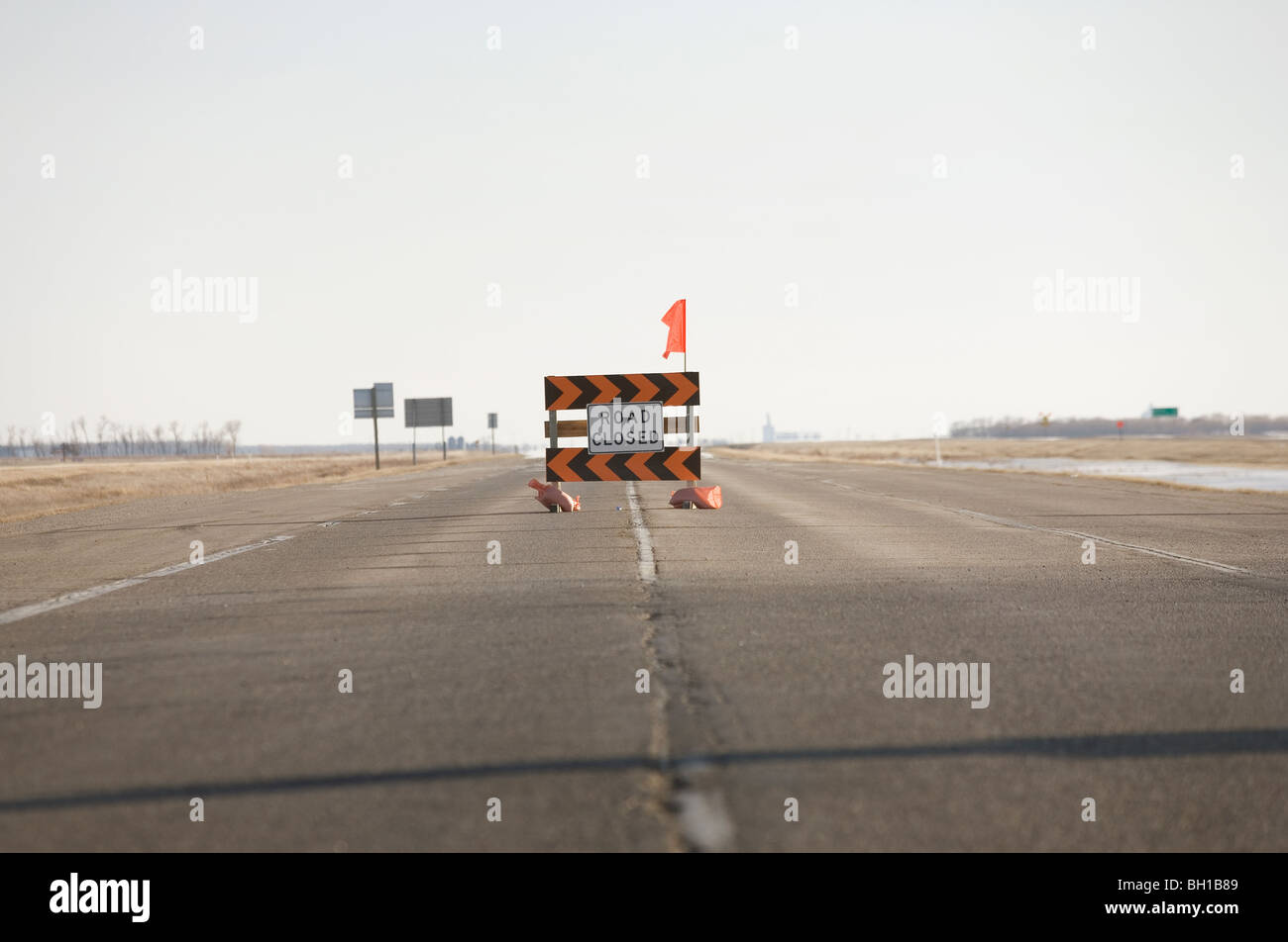 Road closed sign in middle of highway, due to Red River flooding, rural Manitoba, Canada - Stock Image