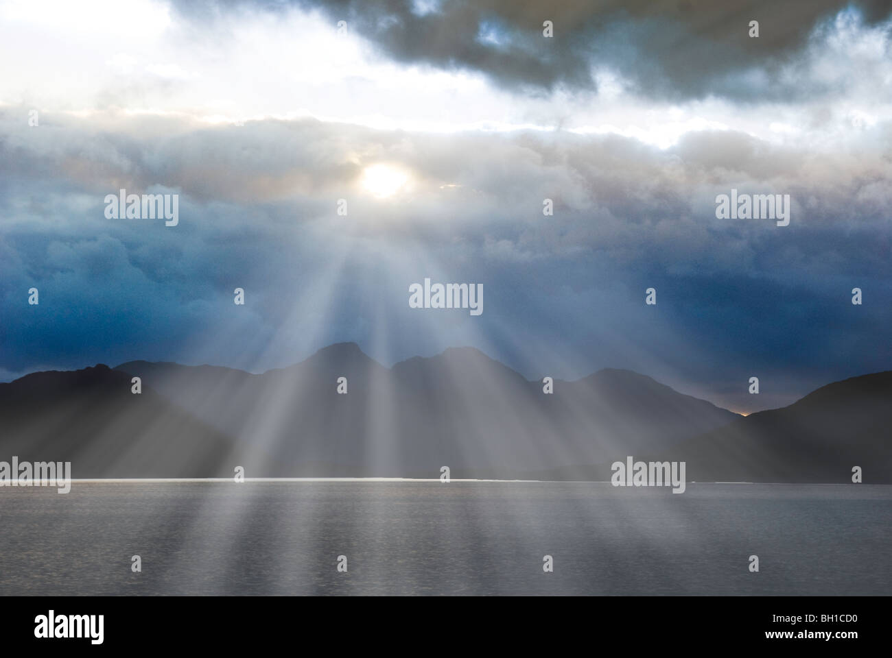 Sunrays over the Strait of Magellan in Chile - Stock Image