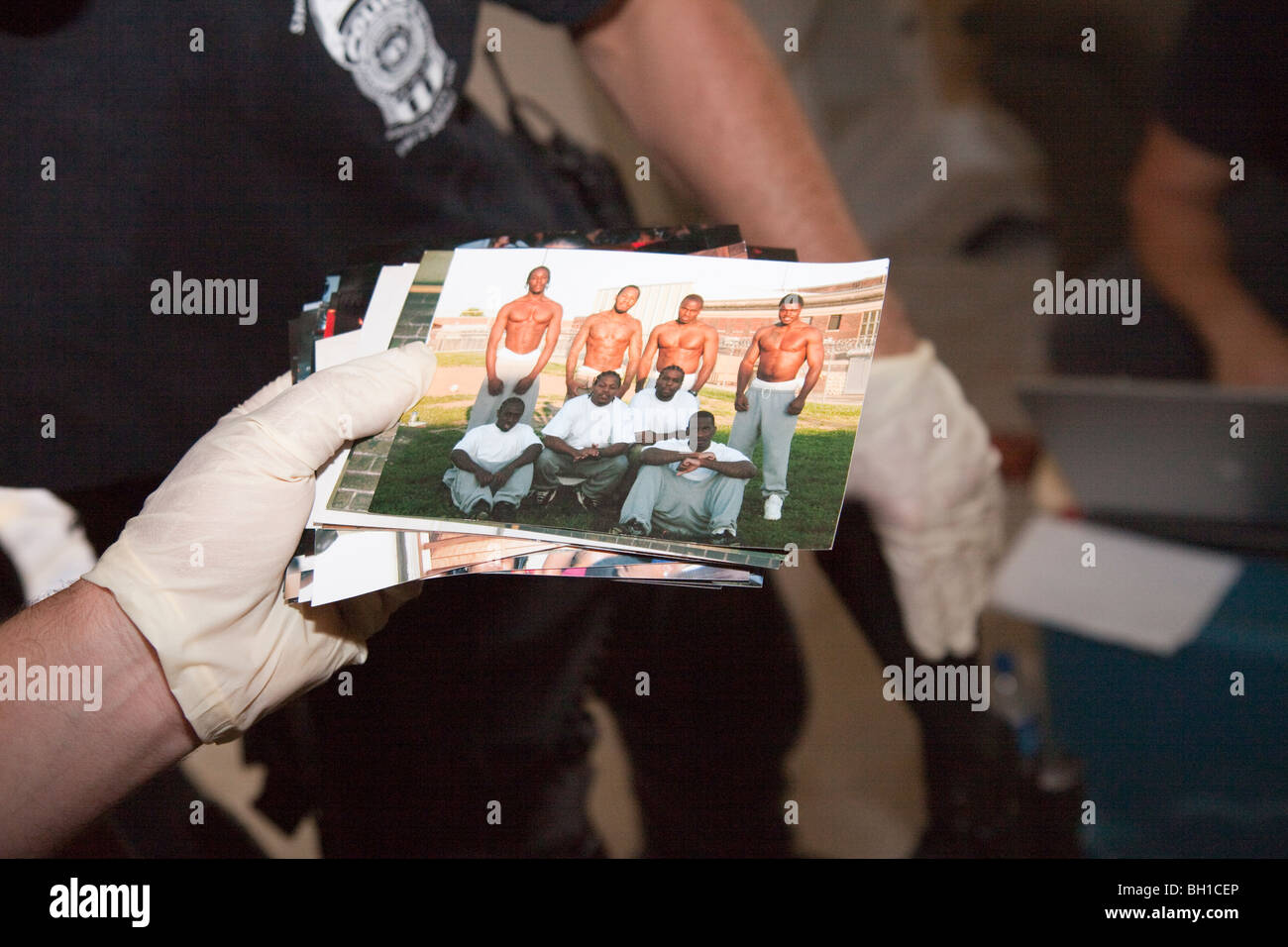 Photos located during the execution of a search warrant. Gang signs. - Stock Image
