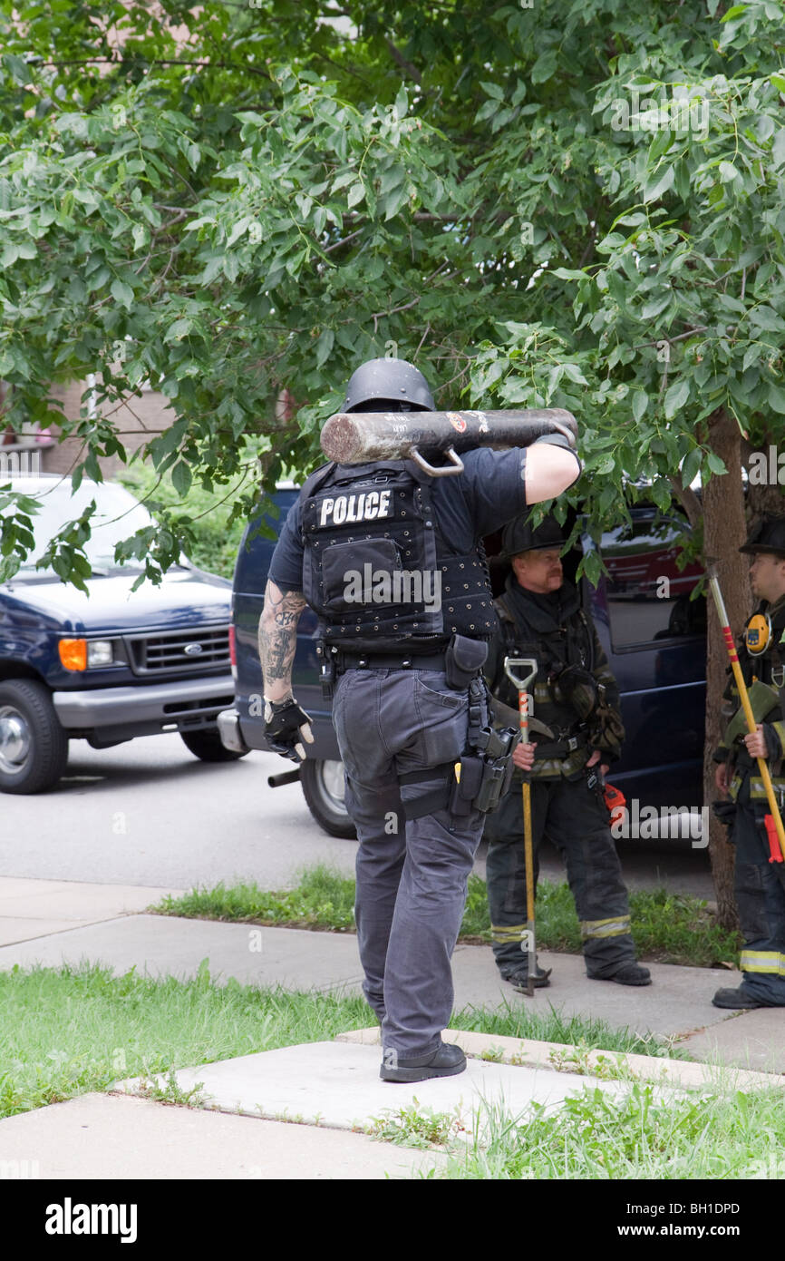 Police officer with battering ram. Kansas City, MO, PD Street Narcotics Unit. Stock Photo