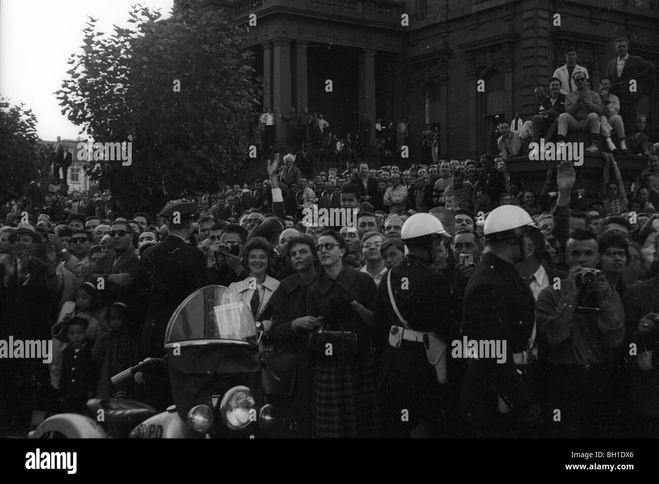 Crowd watches at Nikita Khrushchev tours San Francisco during his 1959 tour of America. - Stock Image