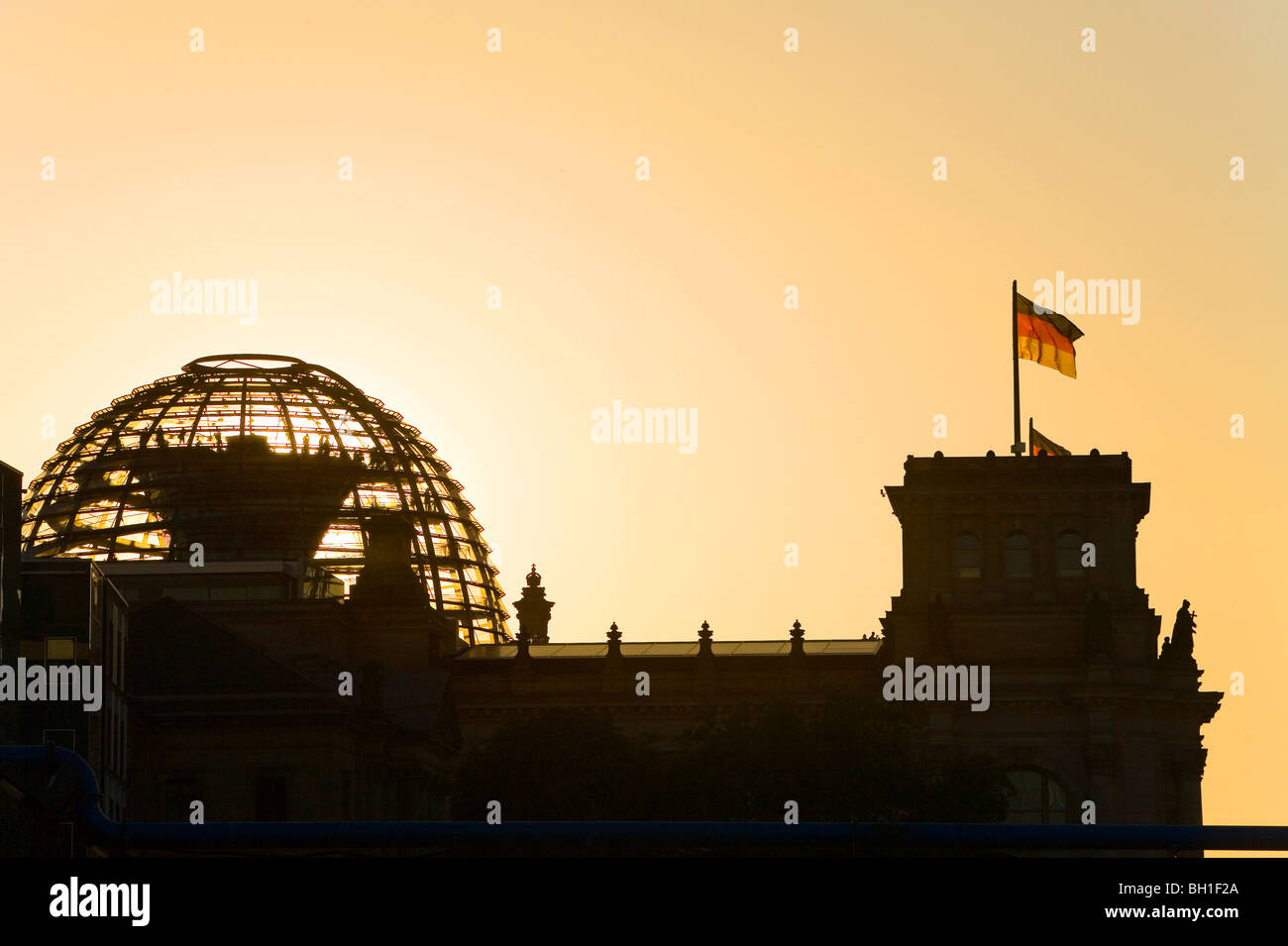 silhouette of German parliament, Reichstag dome at sunset, Berlin, Germany Stock Photo